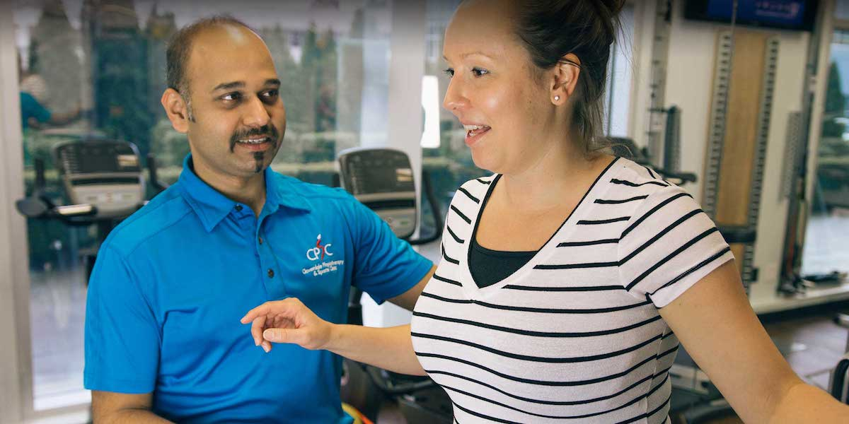 Physiotherapist Working With Customer | Surrey Hwy 10 Physiotherapy and Sport Injury Clinic